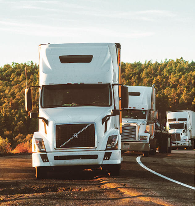 Three Trucks from Sadler Trucking, a Nashville Trucking company, Jacksonville Trucking Company, and Memphis Trucking Company